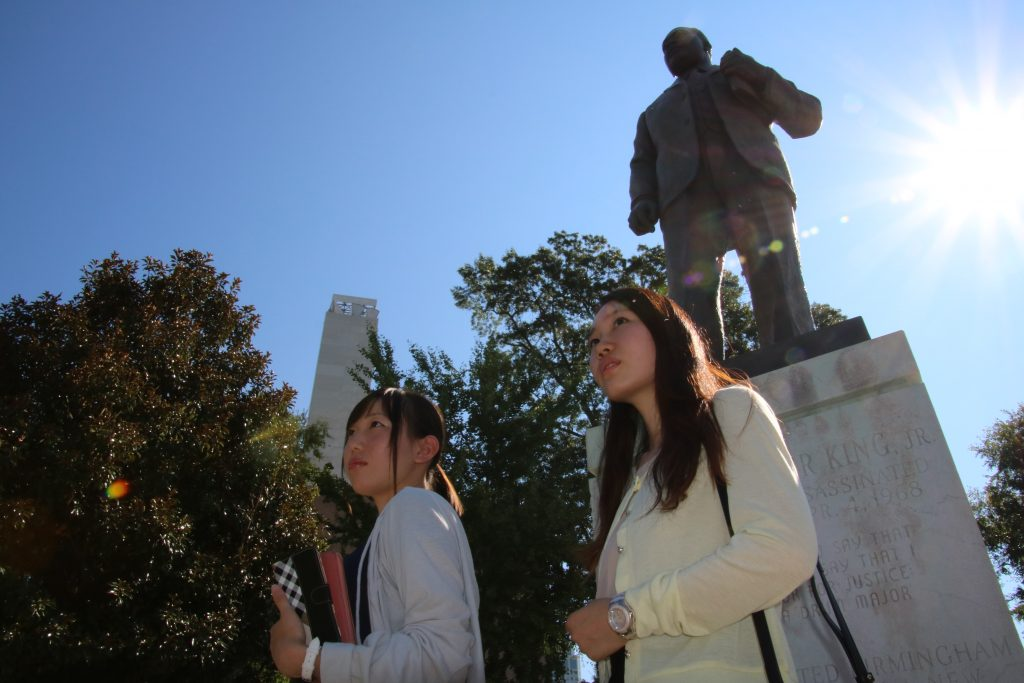 ELI students in front of statue in New Orleans