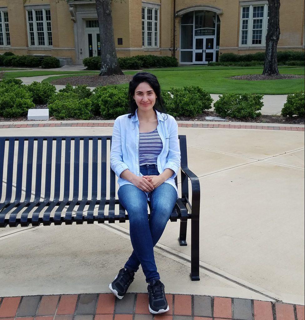 ELI student from Turkey sitting outside B.B. Comer Hall