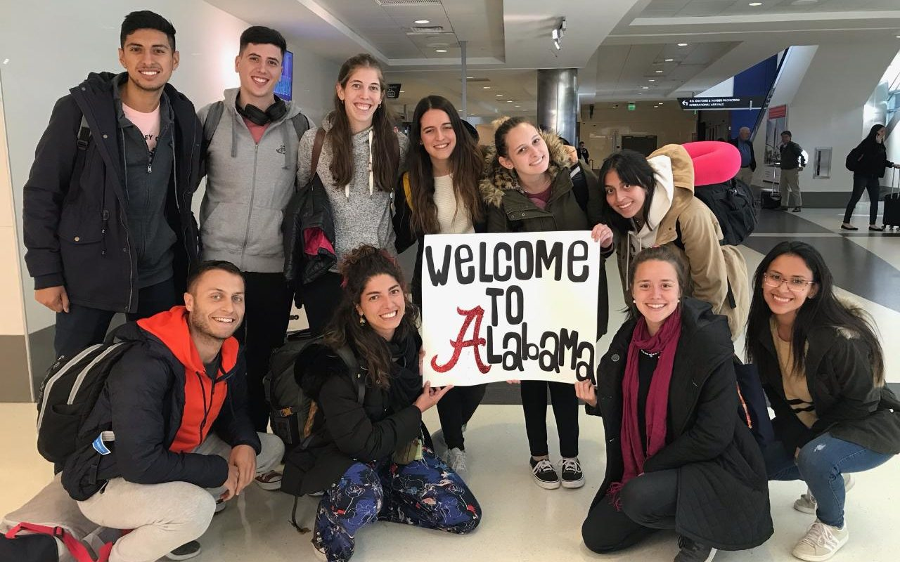 Friends of Fulbright students being welcomed at the airport