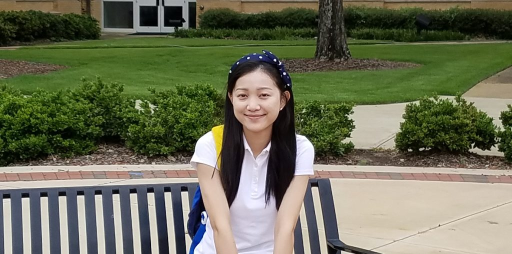 An ELI student Jing from China sitting outside of B.B. Comer.